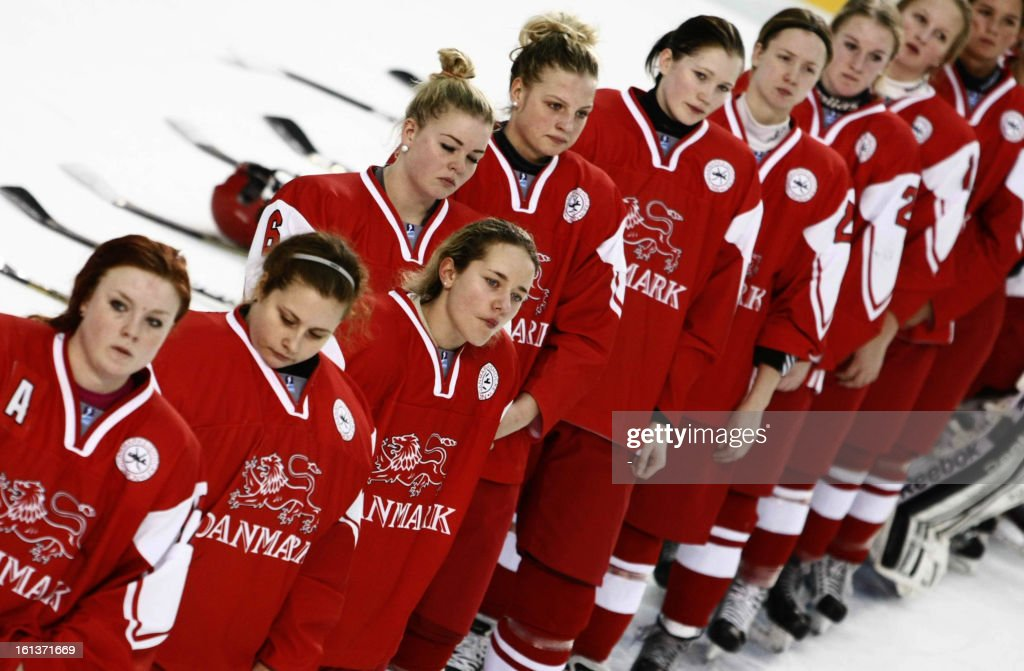 Denmark's players react after the Women's ice hockey Olympic qualification group C match Denmark vs Japan in Poprad on February 10,2013.