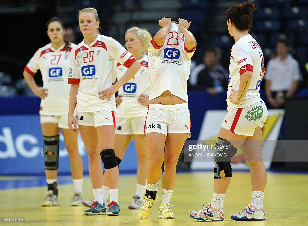 Denmark's players stand after losing to Serbia during their Women's EHF Euro 2012 Handball Championship match Serbia vs Denmark on December 11, 2012, at the Belgrade Arena.