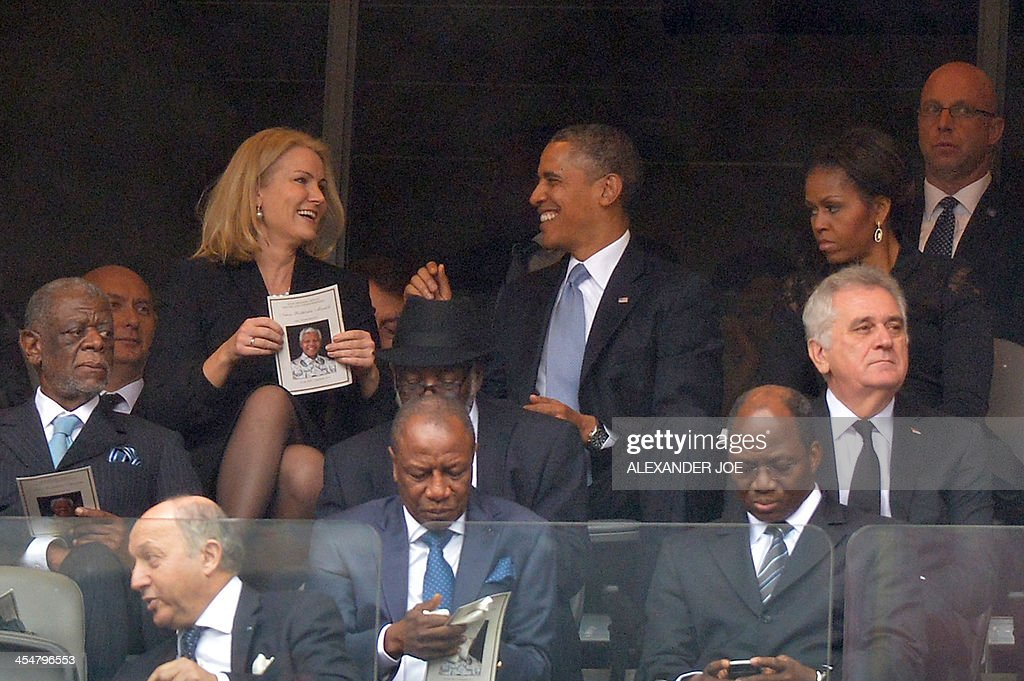 Denmark's Prime Minister Helle Thorning Schmidt (top L) and US President Barack Obama (C) and US First Lady Michelle Obama (top R) for the memorial service of South African former president Nelson Mandela at the FNB Stadium (Soccer City) in Johannesburg on December 10, 2013. Mandela, the revered icon of the anti-apartheid struggle in South Africa and one of the towering political figures of the 20th century, died in Johannesburg on December 5 at age 95.