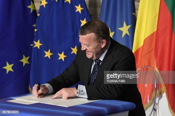 Denmark's Prime Minister Lars Lokke Rasmussen signs the new Rome declaration with leaders of 27 European Union countries special during a summit of...