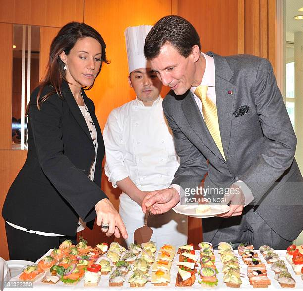 Denmark's Prince Joachim and Princess Marie choose open faced sandwiches as part of their visit at Aoyama Andersen Bakery in Tokyo on November 4 2011...