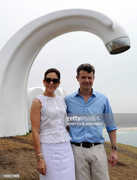Denmark's Princess Mary and her husband Crown Prince Frederik pose for a picture near the fibreglass artwork 'Who Left The Tap Running' by Australian...
