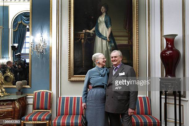 Denmarks Queen Margrethe and Prince Consort Henrik pose for the media on January 10 2012 during a press conference at Amalienborg Palace in...