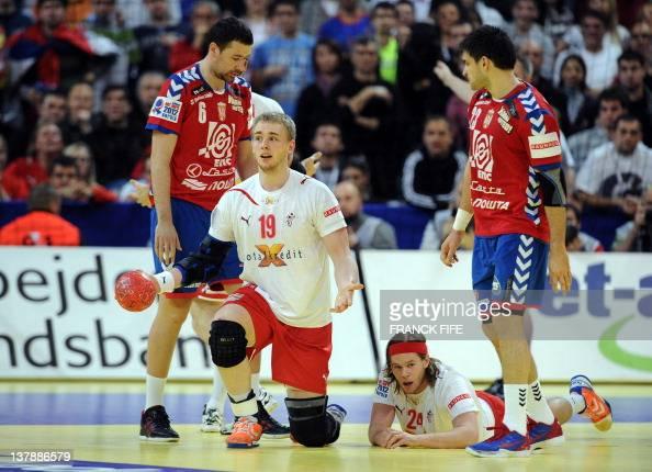 Denmark's René Toft Hansen and Mikkel Hansen gesture next to Serbia's Marko Vujin and Nenad Vuckovic during the men's EHF Euro 2012 Handball...