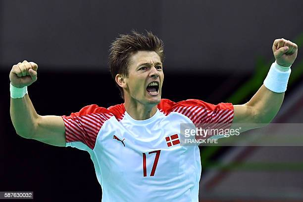 TOPSHOT Denmark's right wing Lasse Svan celebrates a goal during the men's preliminary round Group A handball match between Tunisia and Denmark...