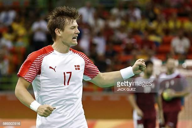 Denmark's right wing Lasse Svan celebrates a goal during the men's preliminaries Group A handball match Denmark vs Qatar for the Rio 2016 Olympics...