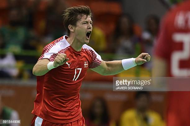 Denmark's right wing Lasse Svan celebrates a goal during the men's quarterfinal handball match Denmark vs Slovenia for the Rio 2016 Olympics Games at...