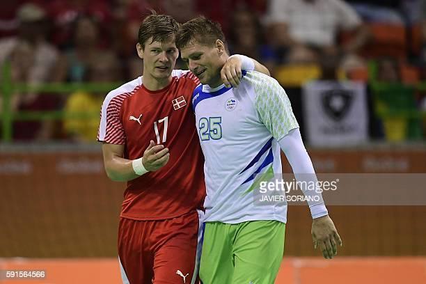 Denmark's right wing Lasse Svan chats with Slovenia's left back Marko Bezjak during the men's quarterfinal handball match Denmark vs Slovenia for the...