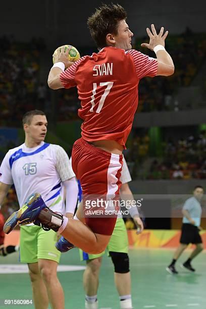 Denmark's right wing Lasse Svan jumps to shoot during the men's quarterfinal handball match Denmark vs Slovenia for the Rio 2016 Olympics Games at...