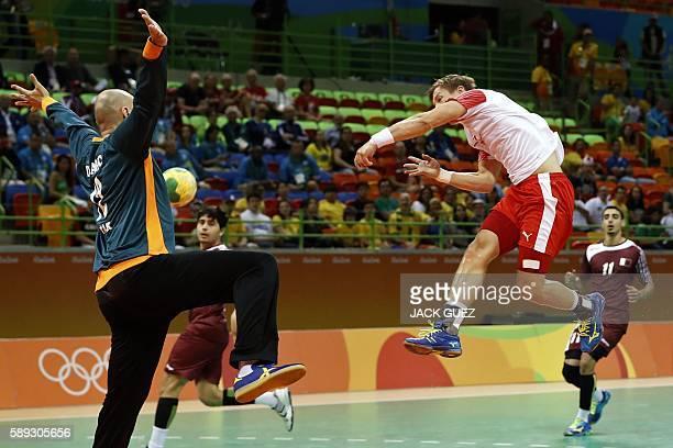 Denmark's right wing Lasse Svan shoots at Qatar's goalkeeper Danijel Saric during the men's preliminaries Group A handball match Denmark vs Qatar for...