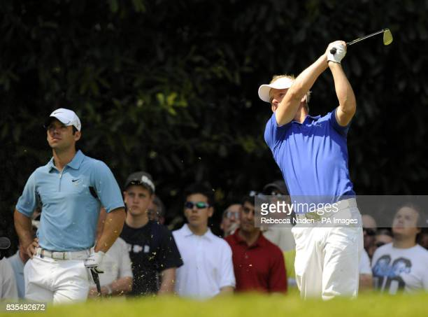 Denmark's Soren Kjeldsen tees off the 2nd hole watched by England's Paul Casey during Round 4 of the BMW PGA Championship at Wentworth Golf Club...