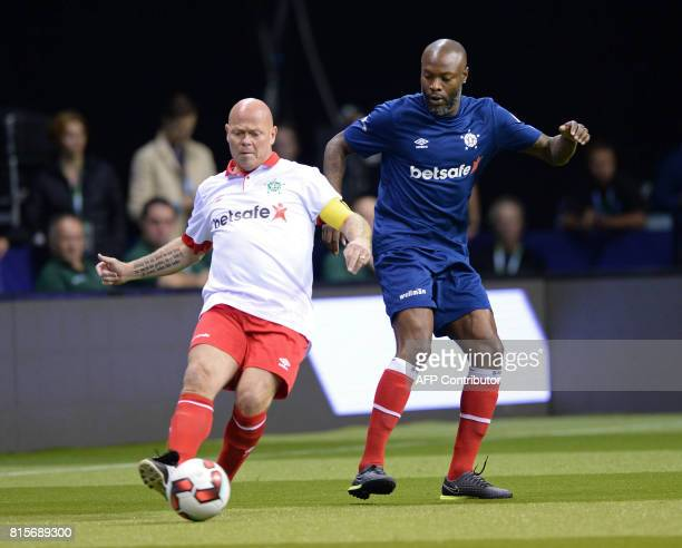 Denmark's Stig Tofting vies with France's William Gallas during the Star Sixes final football match between France and Denmark at the O2 Arena in...