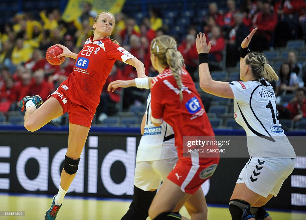 Denmark's Stine Jorgensen (L) challenges Czech's Petra Vitkova (R) during their Women's EHF Euro 2012 Handball Championship match Czech Republic vs Denmark on December 10, 2012, at the Belgrade Arena.