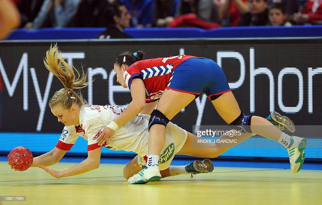 Denmark's Stine Jorgensen (L, down) vies with Serbia's Katarina Krpez during their Women's EHF Euro 2012 Handball Championship match Serbia vs Denmark on December 11, 2012, at the Belgrade Arena.