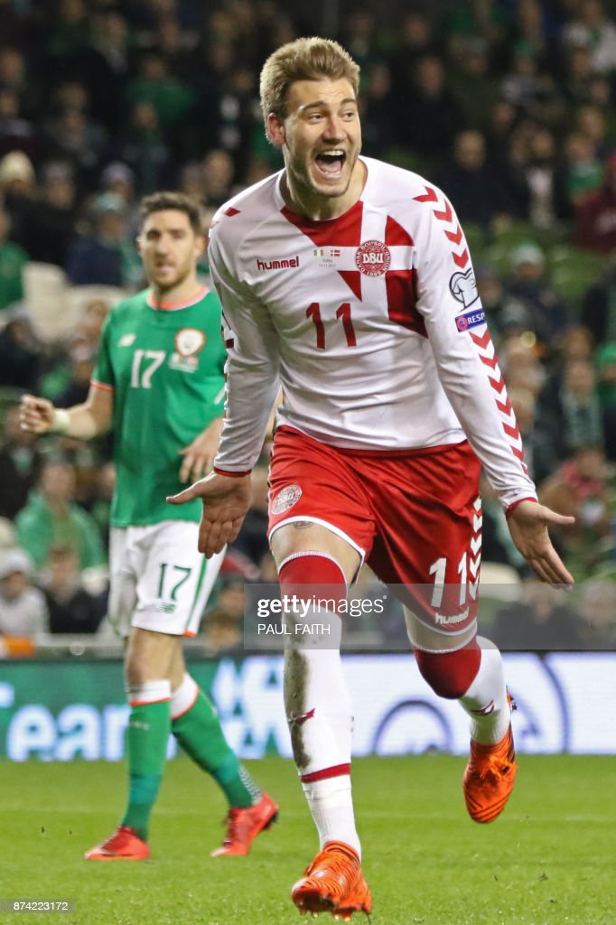 Denmark's striker Nicklas Bendtner celebrates after scoring their fifth goal from the penalty spot during the FIFA World Cup 2018 qualifying football match, second leg, between Republic of Ireland and Denmark at Aviva Stadium in Dublin on November 14, 2017. Christian Eriksen scored a magnificent hat-trick to seal Denmark's place at next year's World Cup after a 5-1 win over the Republic of Ireland in their play-off second leg in Dublin. / AFP PHOTO / Paul FAITH