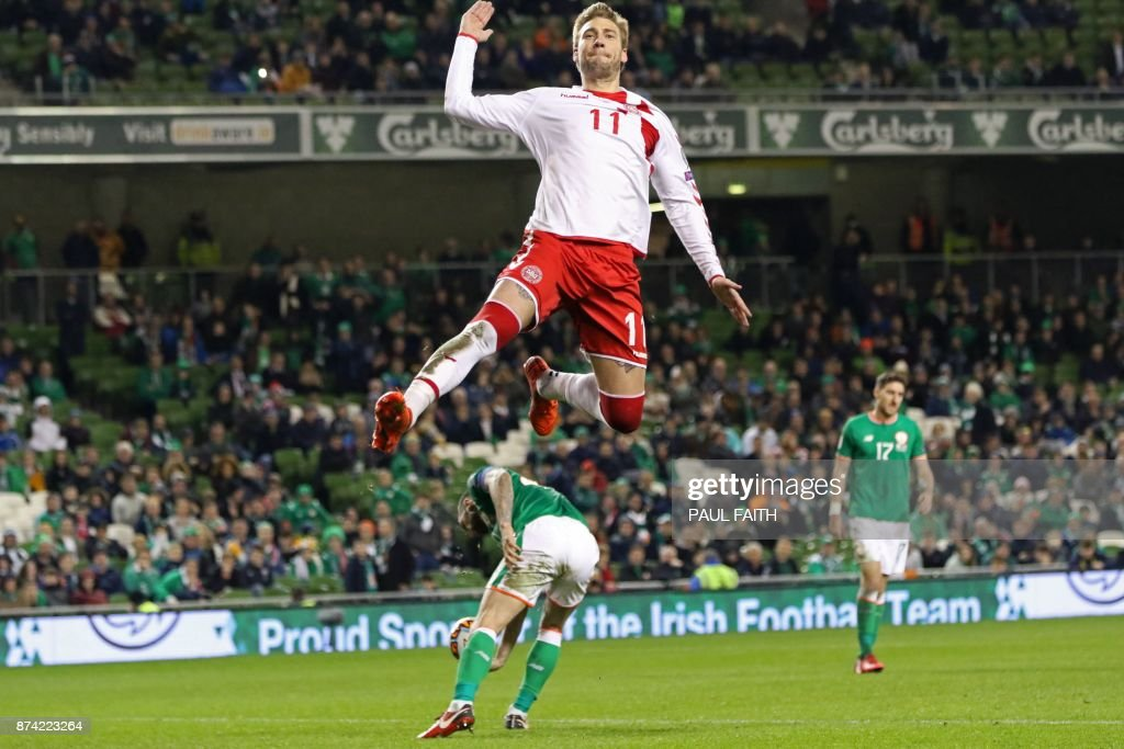 TOPSHOT - Denmark's striker Nicklas Bendtner celebrates after scoring their fifth goal from the penalty spot during the FIFA World Cup 2018 qualifying football match, second leg, between Republic of Ireland and Denmark at Aviva Stadium in Dublin on November 14, 2017. Christian Eriksen scored a magnificent hat-trick to seal Denmark's place at next year's World Cup after a 5-1 win over the Republic of Ireland in their play-off second leg in Dublin. / AFP PHOTO / Paul FAITH