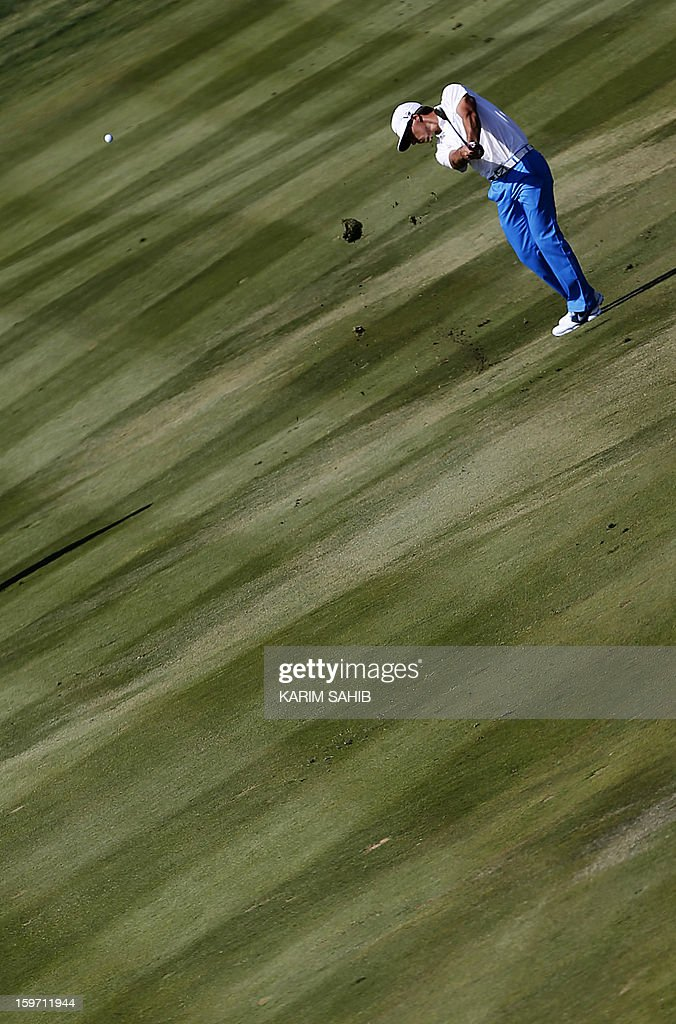 Denmark's Thorbjorn Olesen plays his shot during the third round of the Abu Dhabi Golf Championship at the Abu Dhabi Golf Club in the Emirati capital on January 19, 2013.