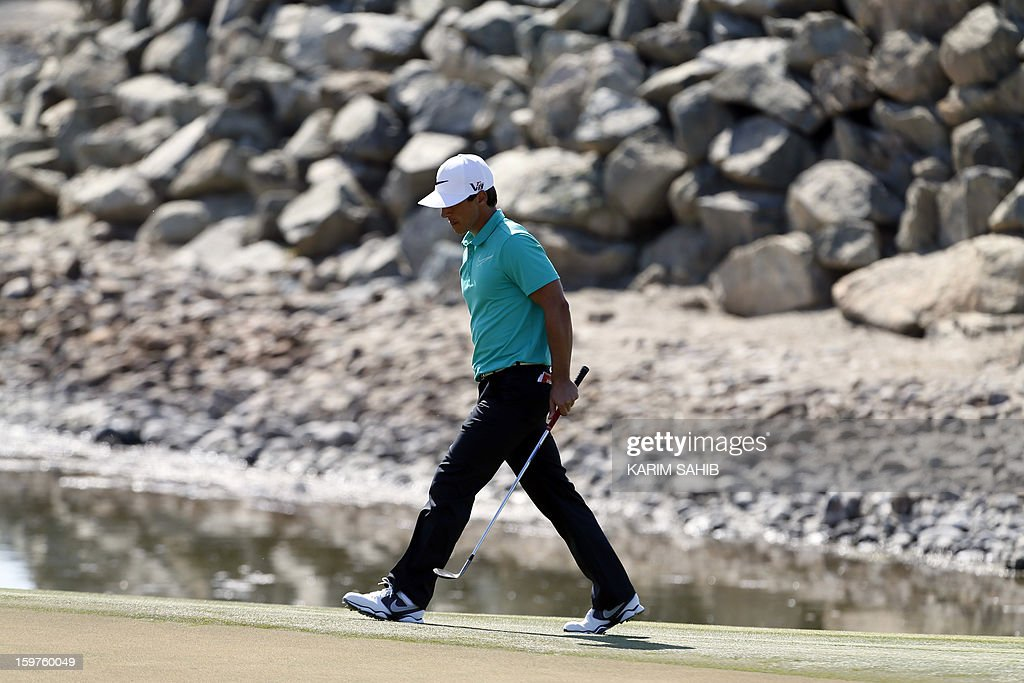 Denmark's Thorbjorn Olesen walks on the green during the final round of the Abu Dhabi Golf Championship at the Abu Dhabi Golf Club in the Emirati capital on January 20, 2013.