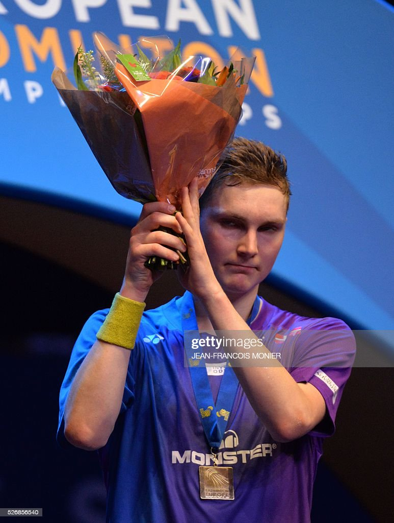 Denmark's Viktor Axelsen and European Champion reacts on the podium after winning the 2016 European Championships Badminton simple men's final match, on May 1, 2016 in Mouilleron-le-Captif, western France. / AFP / JEAN