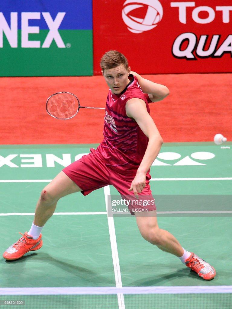 Denmark s Viktor Axelsen hits a shot during the men s singles
