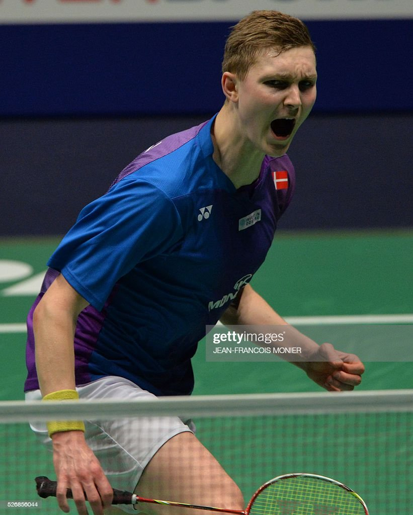 Denmark's Viktor Axelsen reacts after winning a point to Denmark's Jan O Jorgensen during their 2016 European Championships Badminton simple men's final match, on May 1, 2016 in Mouilleron-le-Captif, western France. / AFP / JEAN