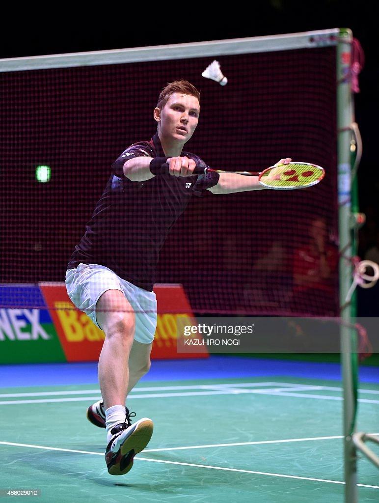 Denmark s Viktor Axelsen returns a shot against China s Lin Dan