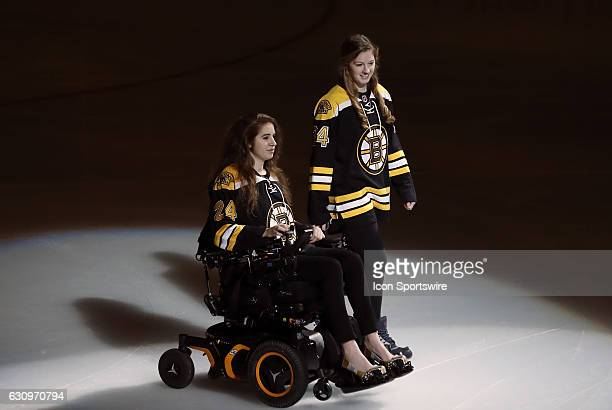 Denna Laing and her sister Lexie head to center ice to drop the puck before a regular season NHL game between the Boston Bruins and the Buffalo...