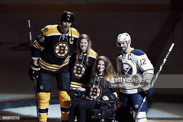Denna Laing and her sister Lexie pose with Boston Bruins left defenseman Zdeno Chara and Buffalo Sabres right wing Brian Gionta after the ceremonial...