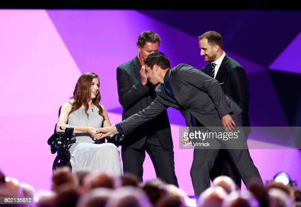 Denna Laing and Travis Hamonic of the New York Islanders shake hands onstage during the 2017 NHL Awards Expansion Draft at TMobile Arena on June 21...