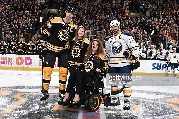 Denna Laing former hockey player who got injured a year ago today poses with her sister Zdeno Chara of the Boston Bruins and Brian Gionta the Buffalo...