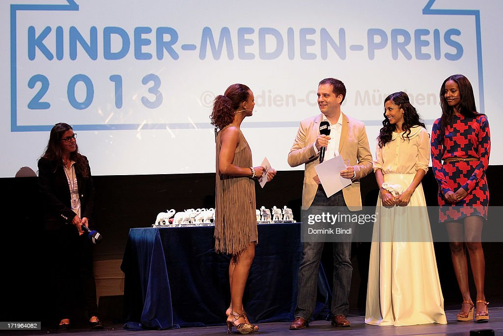 Dennenesch Zoudé, Hannes Heyelmann and Collien Ulmen Fernandes attends the award event 'Kinder-Medien-Preis 2013 at Gasteig on June 30, 2013 in Munich, Germany.Cartoon Network's local production 'Cartoon Network Spurensuche - Schnitzeljagd war gestern' with host Collien Ulmen-Fernandes was awarded at the event.