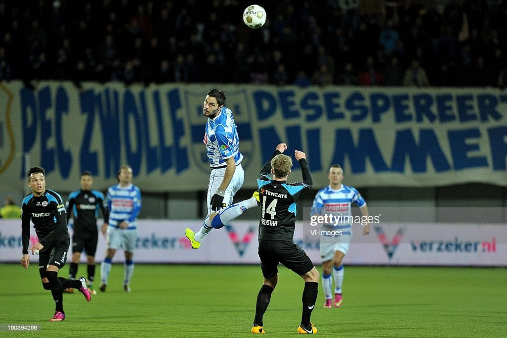 Denni Avdiz of PEC Zwolle, Ben Rienstra of Heracles Almelo during the Dutch Cup match between PEC Zwolle and Heracles Almelo at the IJsseldelta Stadium on january 30, 2013 in Zwolle, The Netherlands