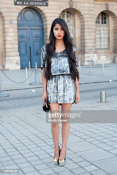 Denni Elias blogger and model wearing a Stella McCartney dress YSL shoes and a vintage bag at Paris Fashion Week Autumn/Winter 2012 haute couture...