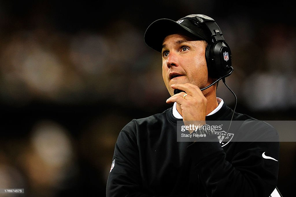 Dennis Allen, head coach of the Oakland Raiders, watches game action during a preseason game against the New Orleans Saints at the Mercedes-Benz Superdome on August 16, 2013 in New Orleans, Louisiana. The Saints won 28-20.