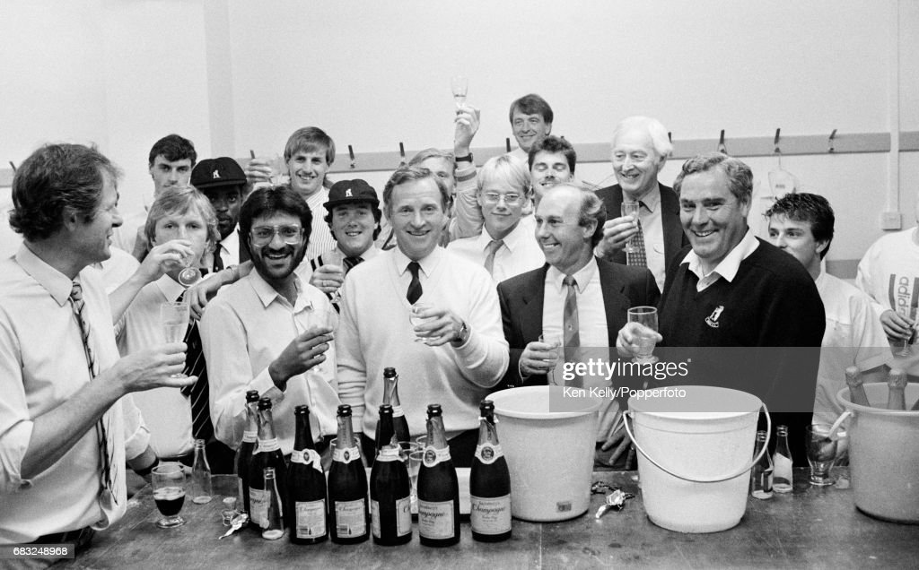 Dennis Amiss of Warwickshire celebrates what should have been his last home match with team-mates in the dressing room after the Refuge Assurance League match against Middlesex was abandoned at Edgbaston, Birmingham, 6th September 1987. Also pictured are (from left): David Brown, (hidden), (unknown), Andy Lloyd, Tony Merrick, Asif Din, Tim Munton, Andy Moles, Dennis Amiss, (hidden), Neil Smith, Alan Smith (rear), (unknown), Neal Abberley, Alan Oakman, John Jameson, (unknown). Andy Moles was presented with his county cap during the day.