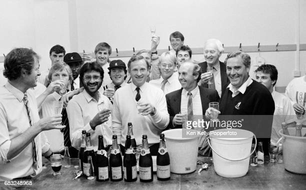 Dennis Amiss of Warwickshire celebrates what should have been his last home match with teammates in the dressing room after the Refuge Assurance...