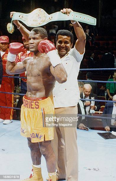 Dennis Andries poses with the belt held up by trainer Manuel Stewart before fight against Sergio Daniel Merani at Royal Albert Hall Kensington in...