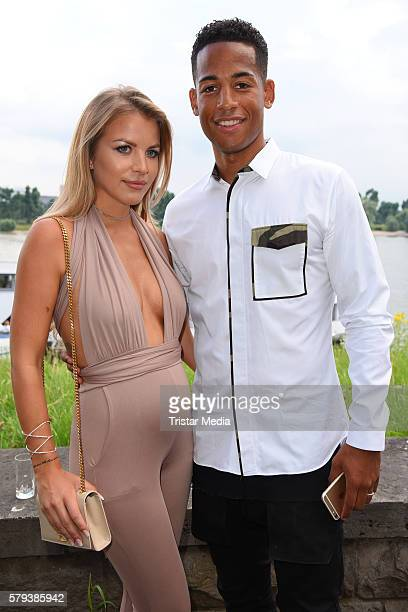 Dennis Aogo and his wife Ina Aogo attend the Airfield loves fashion cocktail on July 23 2016 in Duesseldorf Germany
