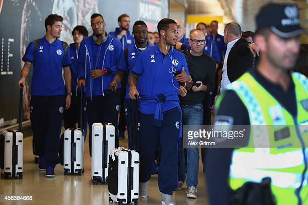 Dennis Aogo and team mates of FC Schalke 04 arrive at Lisbon airport one day ahead of their UEFA Champions League Group G match against Sporting Club...