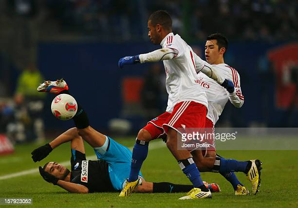 Dennis Aogo and Zhi Gin Lam of Hamburg and Eren Derdiyok of Hoffenheim compete for the ball during the Bundesliga match between Hamburger SV and TSG...