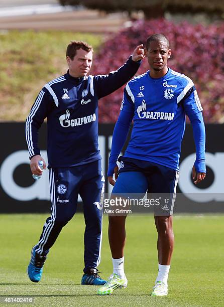 Dennis Aogo hobbles next to physiotherapist Thomas Kuehn during day 7 of the FC Schalke 04 training camp at the ASPIRE Academy for Sports Excellence...