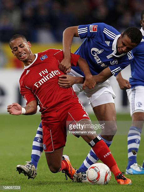 Dennis Aogo of Hamburg and Joel Matip of Schalke battle for the ball during the Bundesliga match between FC Schalke 04 and Hamburger SV at Veltins...