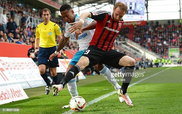 Dennis Aogo of Schalke abd Moritz Hartmann of Ingolstadt compete for the ball during the Bundesliga match between FC Ingolstadt and FC Schalke 04 at...