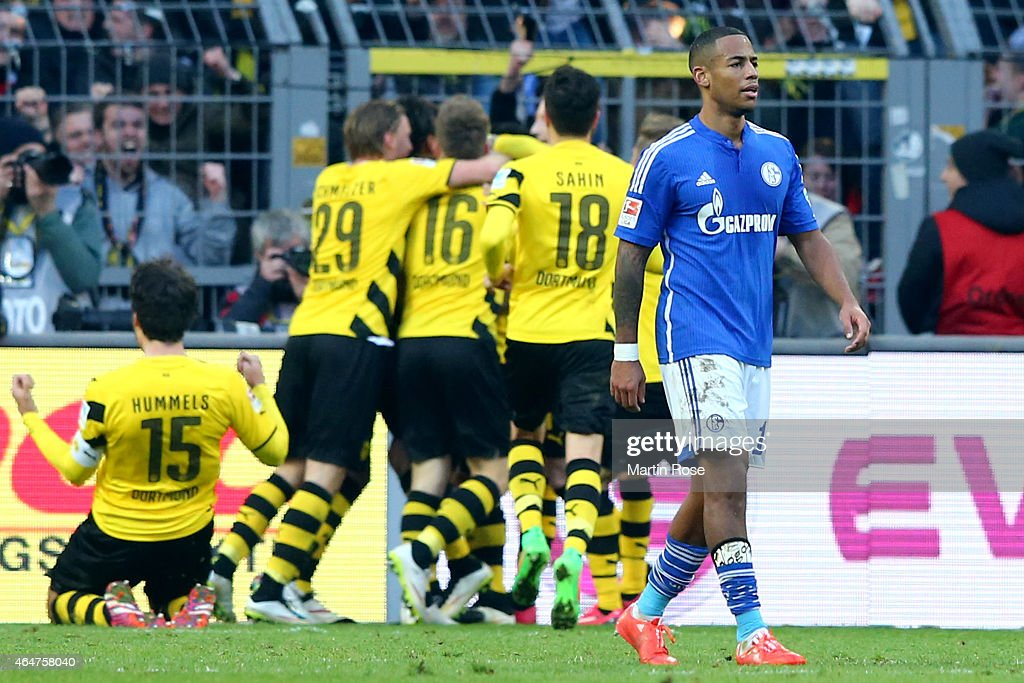 <a gi-track='captionPersonalityLinkClicked' href=/galleries/search?phrase=Dennis+Aogo&family=editorial&specificpeople=787086 ng-click='$event.stopPropagation()'>Dennis Aogo</a> of Schalke looks dejected whilst players of Dortmund celebrate the first team goal during the Bundesliga match between Borussia Dortmund and FC Schalke 04 at Signal Iduna Park on February 28, 2015 in Dortmund, Germany.