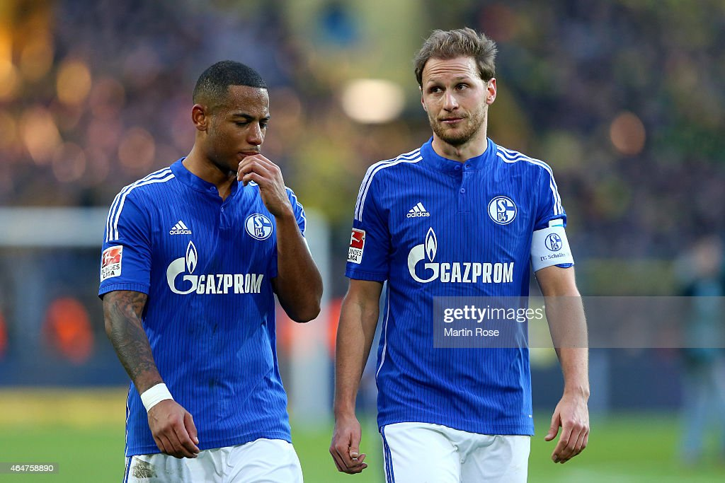 <a gi-track='captionPersonalityLinkClicked' href=/galleries/search?phrase=Dennis+Aogo&family=editorial&specificpeople=787086 ng-click='$event.stopPropagation()'>Dennis Aogo</a> (L) of Schalke reacts with his team mate Benedik Hoewedes after the Bundesliga match between Borussia Dortmund and FC Schalke 04 at Signal Iduna Park on February 28, 2015 in Dortmund, Germany.