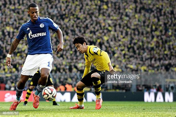 Dennis Aogo of Schalke vies with Shinji Kagawa of Dortmund during the Bundesliga match between Borussia Dortmund and FC Schalke 04 at Signal Iduna...