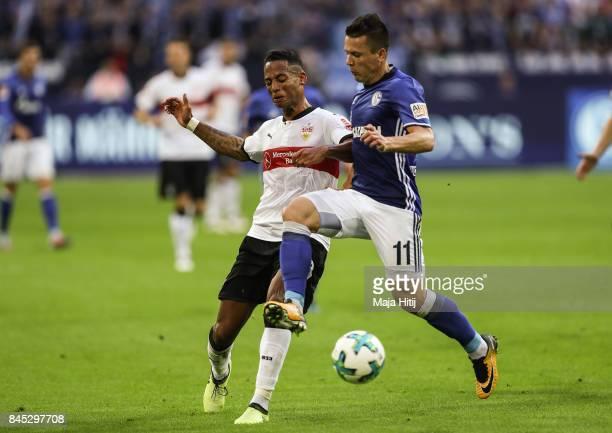 Dennis Aogo of Stuttgart and Yevhen Konoplyanka of Schalke battle for the ball during the Bundesliga match between FC Schalke 04 and VfB Stuttgart at...