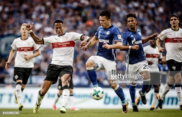 Dennis Aogo of Stuttgart is challenged by Yevhen Konoplyanka of Schalke during the Bundesliga match between FC Schalke 04 and VfB Stuttgart at...