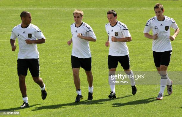 Dennis Aogo Philipp Lahm Piotr Trochowski and Miroslav Klose of Germany exercise during training session at Sportzone Rungg on May 31 2010 in Appiano...