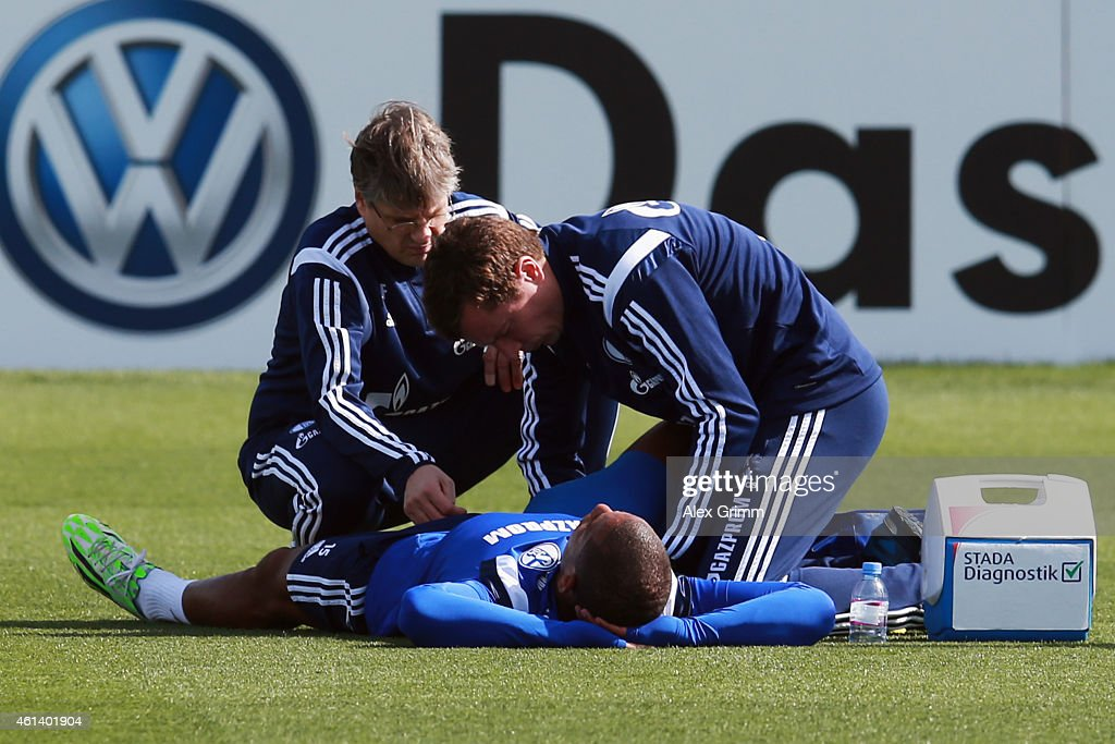 <a gi-track='captionPersonalityLinkClicked' href=/galleries/search?phrase=Dennis+Aogo&family=editorial&specificpeople=787086 ng-click='$event.stopPropagation()'>Dennis Aogo</a> receives treatment during day 7 of the FC Schalke 04 training camp at the ASPIRE Academy for Sports Excellence on January 12, 2015 in Doha, Qatar.